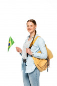 Fotografie smiling pretty student with backpack holding flag of Brazil isolated on white