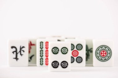 KYIV, UKRAINE - JANUARY 30, 2019: selective focus of mahjong game tiles with signs and characters on white background with copy space stock vector