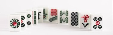 KYIV, UKRAINE - JANUARY 30, 2019: selective focus of mahjong game tiles with signs and characters on white background, panoramic shot stock vector