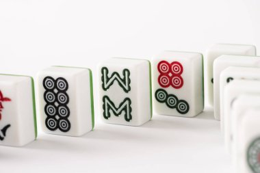KYIV, UKRAINE - JANUARY 30, 2019: selective focus of mahjong game tiles with signs and characters on white background stock vector