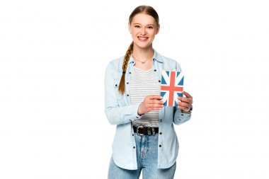 smiling pretty girl with braid holding book with uk flag isolated on white
