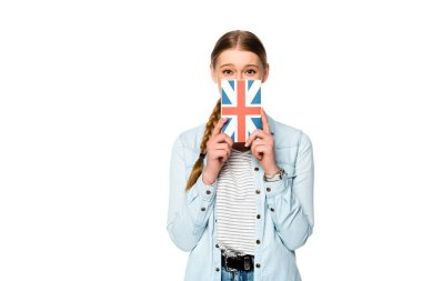 pretty girl with obscure face holding book with uk flag isolated on white