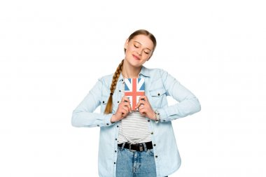 smiling pretty girl with braid and closed eyes holding book with uk flag isolated on white