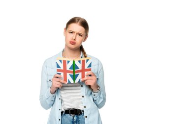 worried pretty girl with braid reading book with uk flag isolated on white