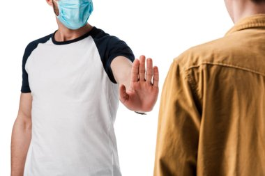 Cropped view of man in medical mask showing stop gesture near guy isolated on white stock vector