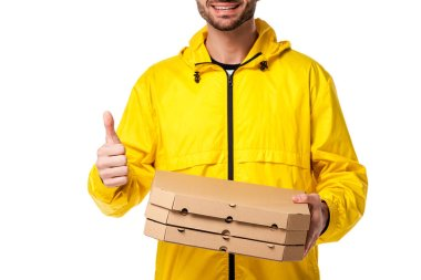Cropped view of happy delivery man with pizza boxes showing thumb up isolated on white stock vector