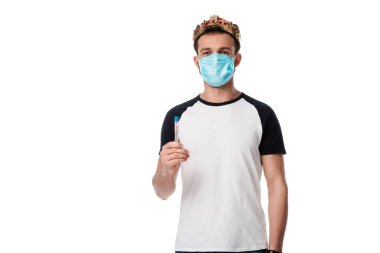 man in medical mask and crown holding test tube with coronavirus blood sample lettering isolated on white