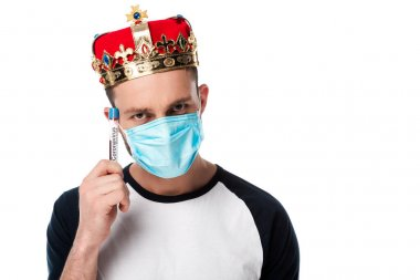 man in medical mask and crown holding test tube with blood sample isolated on white