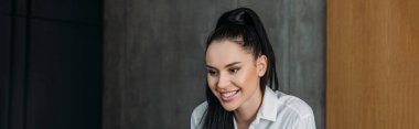Horizontal image of smiling brunette woman in white shirt stock vector