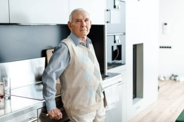 Sad elderly man standing on kitchen during self isolation stock vector