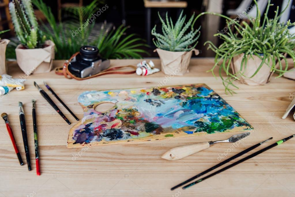 Creative workplace with art supplies
