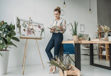 businesswoman with book in office