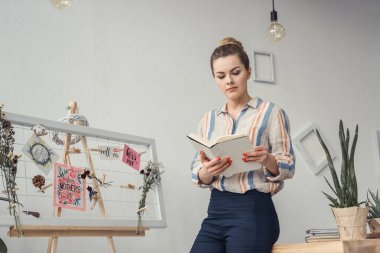 businesswoman with book at workplace