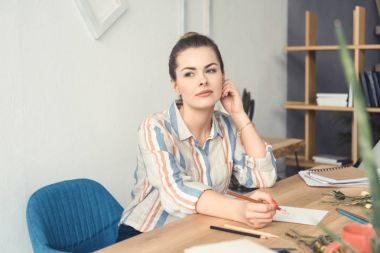 attractive businesswoman at workplace