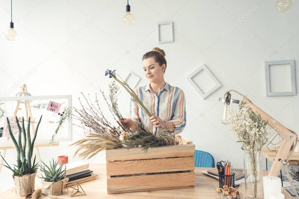 florist with flowers at workplace