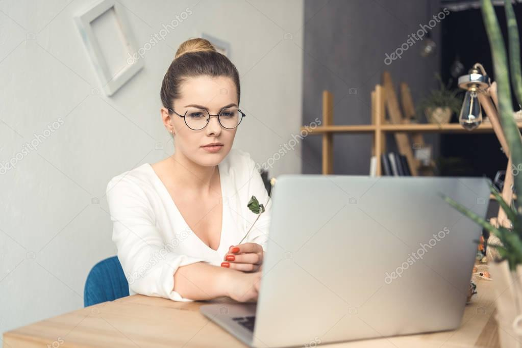 florist with laptop at workplace