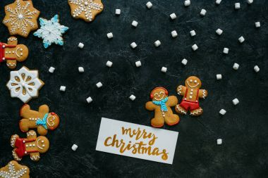 christmas gingerbreads, marshmallows and greeting card