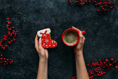 christmas gingerbread and coffee in hands