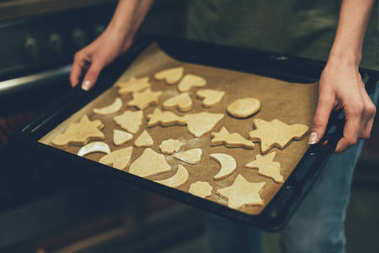 person baking christmas cookies