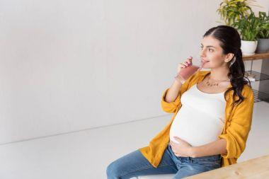 pregnant woman drinking detox