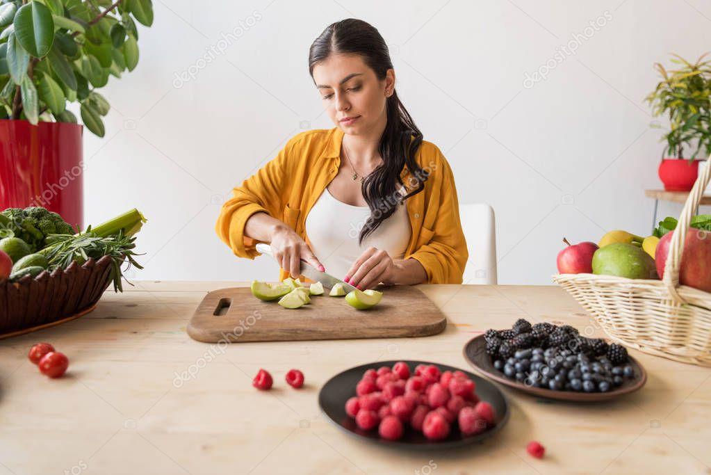 woman cutting fresh apple