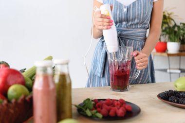 woman cooking detox drink