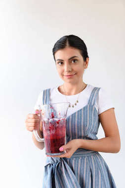 woman holding glass jar of detox