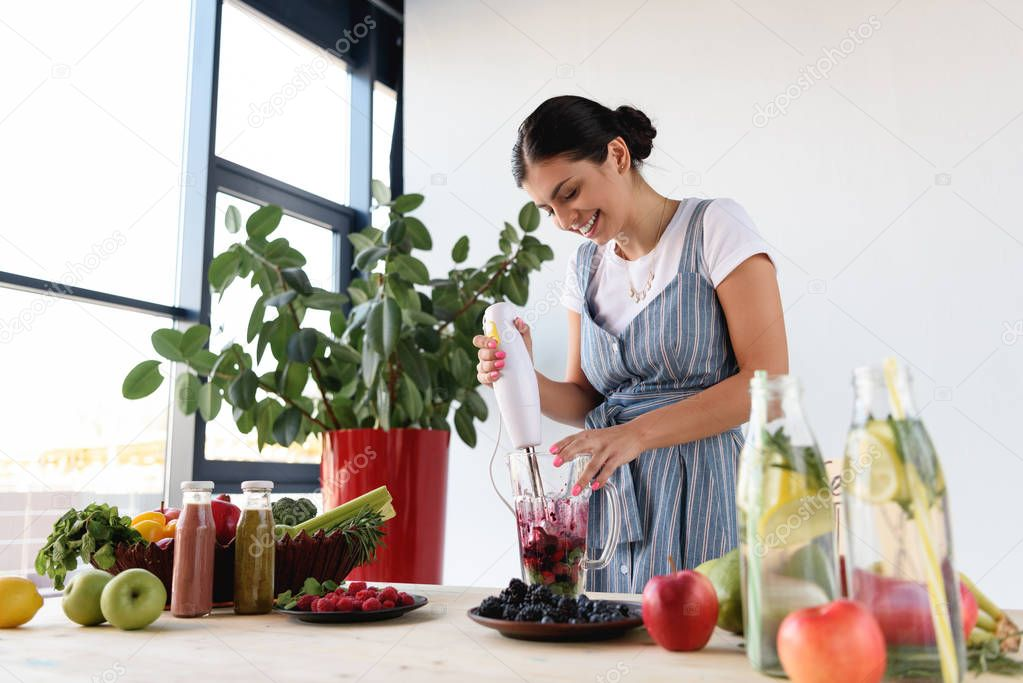 young woman making detox drink