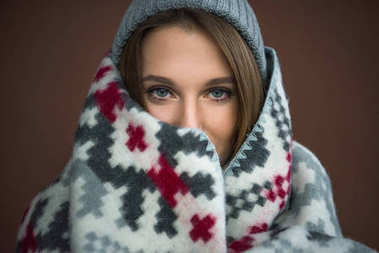 woman wrapped in blanket