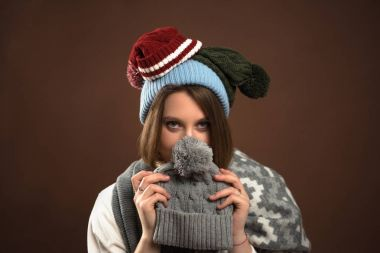 Woman looking out from winter hat