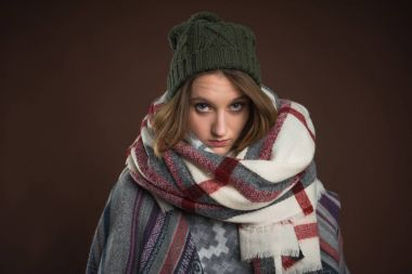 Upset girl in winter clothes