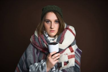 Girl holding thermos cup