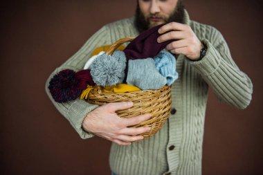 man taking scarf