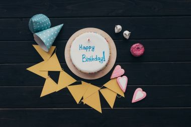 birthday cake with triangular paper garland