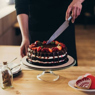 woman cutting chocolate cake