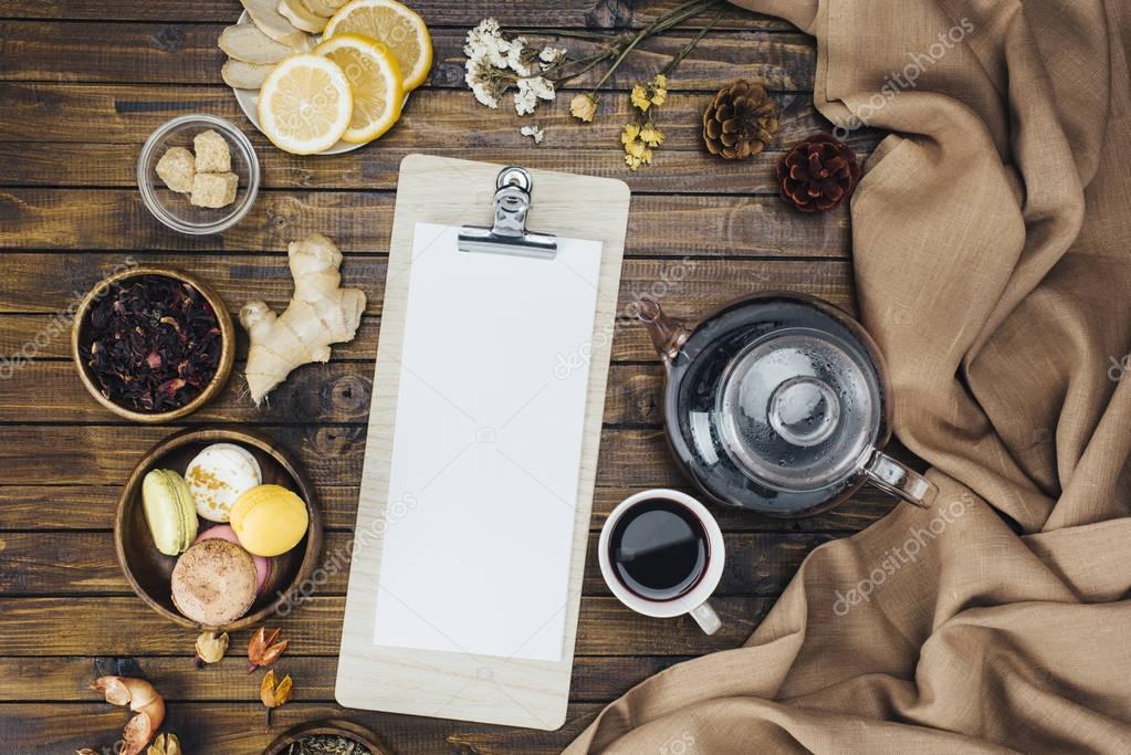 blank clipboard and tea set