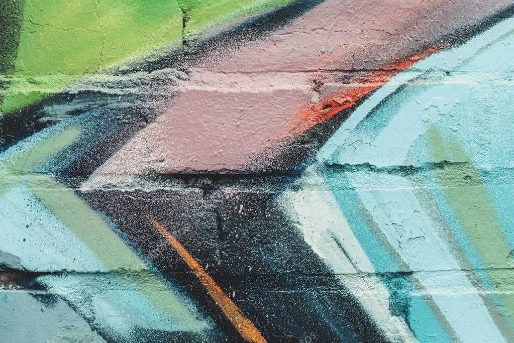 close up texture of colorful graffiti on wall