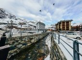 cold river at austrian town in snowy mountains
