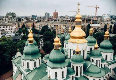 aerial view of Kiev Pechersk Lavra church against beautiful city, Ukraine