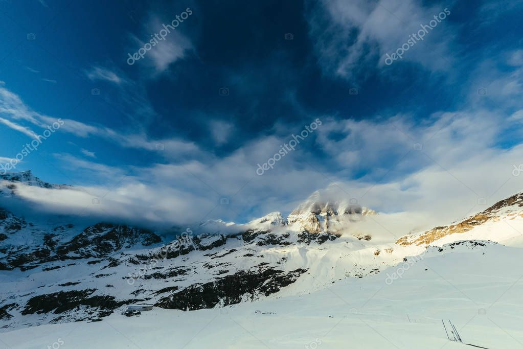 tranquil snowy mountains landscape with blue sky, Austria