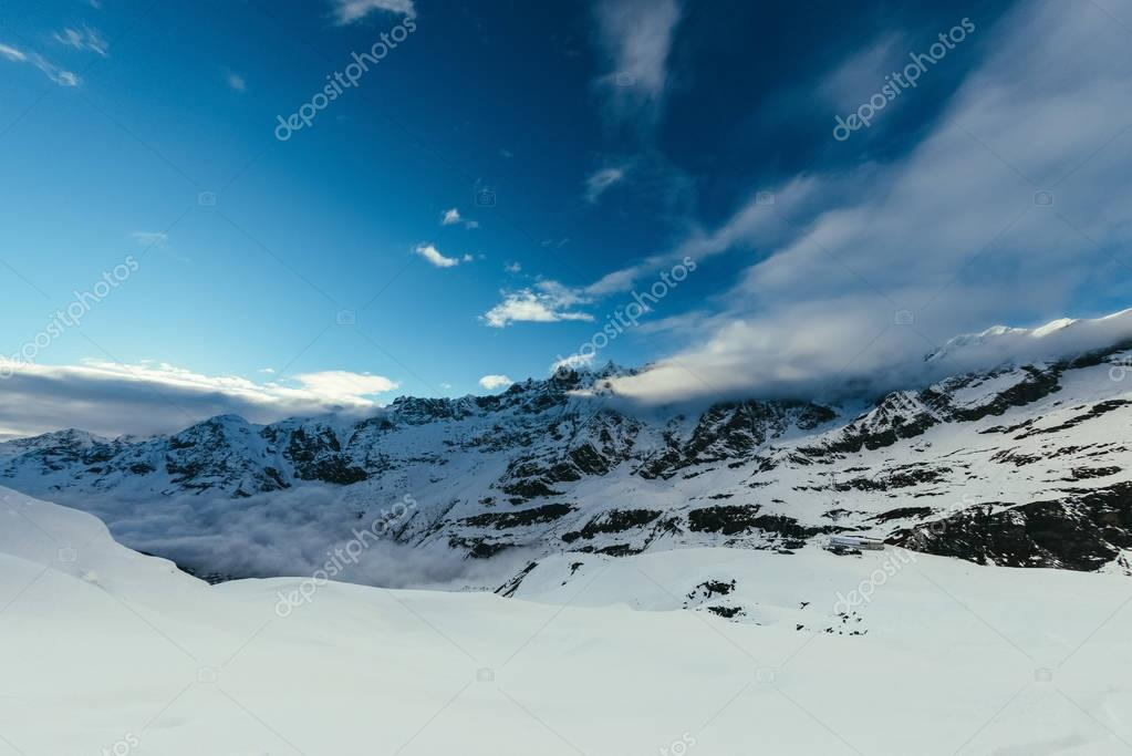 beautiful mountains landscape under blue sky with tiny clouds, Austria