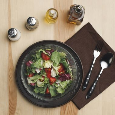 Flat lay with arranged salad in bowl, spices and bottles of oil on wooden surface stock vector