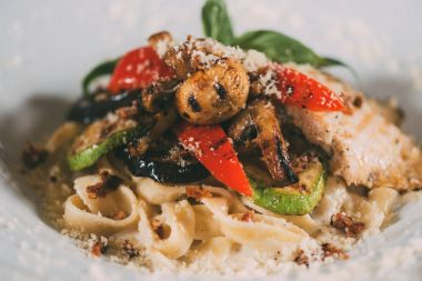 gourmet vegetarian pasta with grilled vegetables and parmesan cheese