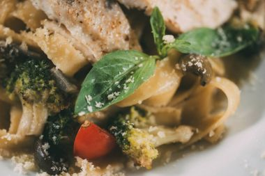 close-up view of delicious vegetarian pasta with grilled vegetables