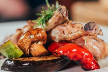 close-up view of gourmet grilled chicken with mushroom, pepper, rosemary, zucchini and eggplant