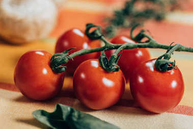 close-up view of fresh ripe cherry tomatoes on table napkin