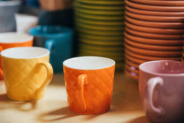 close-up view of empty colorful cups and plates on tabletop