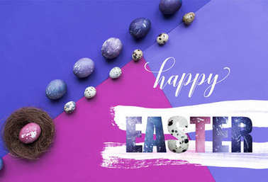Rows of painted chicken and quail eggs and nest with happy easter lettering on background in purple tones