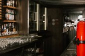 Photo beer pipe taps in modern pub