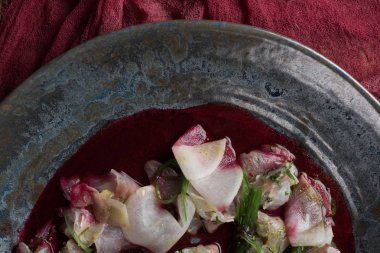 close-up view of delicious ceviche with dorado in plate